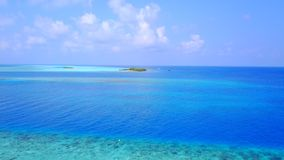 P01120 Aerial flying drone view of Maldives white sandy beach on sunny tropical paradise island with aqua blue sky sea Stock Photo