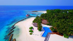 P01197 Aerial flying drone view of Maldives white sandy beach on sunny tropical paradise island with aqua blue sky sea Stock Photography