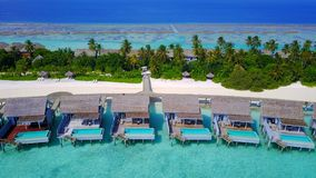 P01203 Aerial flying drone view of Maldives white sandy beach on sunny tropical paradise island with aqua blue sky sea. Aerial flying drone view of Maldives Royalty Free Stock Images