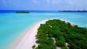 P01126 Aerial flying drone view of Maldives white sandy beach on sunny tropical paradise island with aqua blue sky sea Stock Image