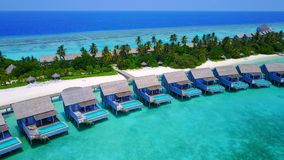 P01211 Aerial flying drone view of Maldives white sandy beach on sunny tropical paradise island with aqua blue sky sea Stock Photography