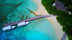 P01235 Aerial flying drone view of Maldives white sandy beach on sunny tropical paradise island with aqua blue sky sea. Aerial flying drone view of Maldives Stock Photos