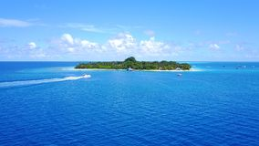 P01144 Aerial flying drone view of Maldives white sandy beach on sunny tropical paradise island with aqua blue sky sea Stock Photography