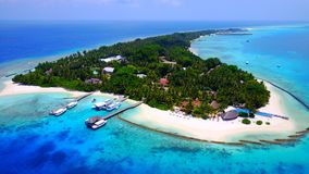P01244 Aerial flying drone view of Maldives white sandy beach on sunny tropical paradise island with aqua blue sky sea Royalty Free Stock Photography