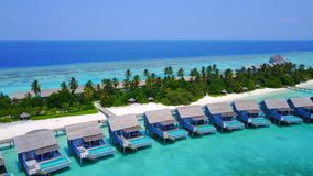 P01242 Aerial flying drone view of Maldives white sandy beach on sunny tropical paradise island with aqua blue sky sea Stock Photography