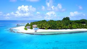 P02285 Aerial flying drone view of Maldives white sandy beach on sunny tropical paradise island with aqua blue sky sea Royalty Free Stock Photos