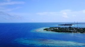 P02341 Aerial flying drone view of Maldives white sandy beach on sunny tropical paradise island with aqua blue sky sea Royalty Free Stock Image