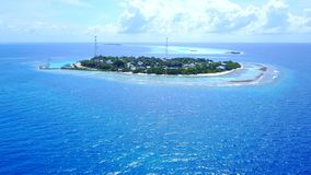 P02507 Aerial flying drone view of Maldives white sandy beach on sunny tropical paradise island with aqua blue sky sea Stock Images