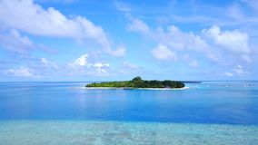 P02358 Aerial flying drone view of Maldives white sandy beach on sunny tropical paradise island with aqua blue sky sea Royalty Free Stock Photo