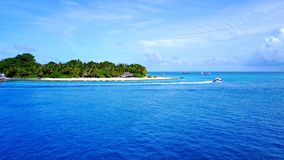 P02465 Aerial flying drone view of Maldives white sandy beach on sunny tropical paradise island with aqua blue sky sea Stock Images