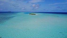 P02340 Aerial flying drone view of Maldives white sandy beach on sunny tropical paradise island with aqua blue sky sea Stock Images