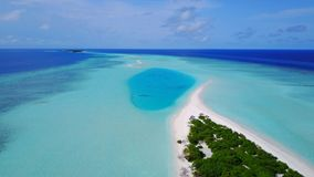 P02415 Aerial flying drone view of Maldives white sandy beach on sunny tropical paradise island with aqua blue sky sea Stock Photos
