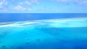 P02391 Aerial flying drone view of Maldives white sandy beach on sunny tropical paradise island with aqua blue sky sea Royalty Free Stock Images