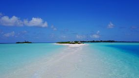 P02419 Aerial flying drone view of Maldives white sandy beach on sunny tropical paradise island with aqua blue sky sea Royalty Free Stock Photo