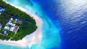 P02232 Aerial flying drone view of Maldives white sandy beach on sunny tropical paradise island with aqua blue sky sea Royalty Free Stock Photos