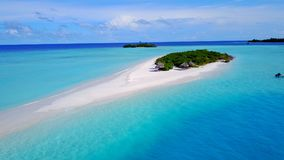P02423 Aerial flying drone view of Maldives white sandy beach on sunny tropical paradise island with aqua blue sky sea Royalty Free Stock Photography