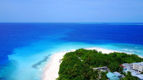 P02332 Aerial flying drone view of Maldives white sandy beach on sunny tropical paradise island with aqua blue sky sea Royalty Free Stock Photos