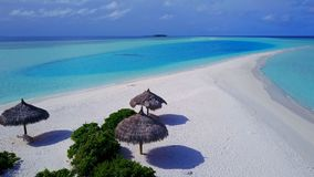 P02323 Aerial flying drone view of Maldives white sandy beach on sunny tropical paradise island with aqua blue sky sea Royalty Free Stock Image
