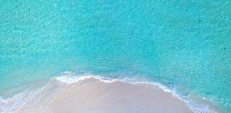 P02706 Aerial flying drone view of Maldives white sandy beach on sunny tropical paradise island with aqua blue sky sea Stock Photography