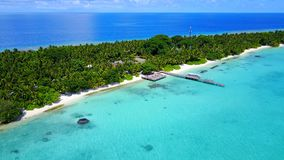 P02501 Aerial flying drone view of Maldives white sandy beach on sunny tropical paradise island with aqua blue sky sea Stock Photography