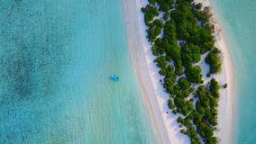 P02449 Aerial flying drone view of Maldives white sandy beach on sunny tropical paradise island with aqua blue sky sea Royalty Free Stock Photos