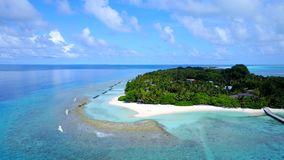 P02270 Aerial flying drone view of Maldives white sandy beach on sunny tropical paradise island with aqua blue sky sea Stock Image