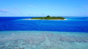 P02291 Aerial flying drone view of Maldives white sandy beach on sunny tropical paradise island with aqua blue sky sea Stock Photography