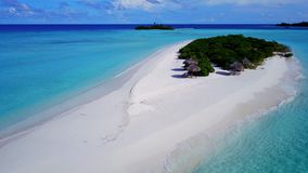 P02363 Aerial flying drone view of Maldives white sandy beach on sunny tropical paradise island with aqua blue sky sea Stock Photo