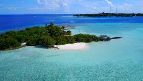 P02305 Aerial flying drone view of Maldives white sandy beach on sunny tropical paradise island with aqua blue sky sea Royalty Free Stock Photo