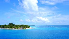 P02400 Aerial flying drone view of Maldives white sandy beach on sunny tropical paradise island with aqua blue sky sea Stock Images