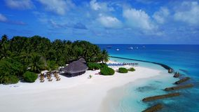 P02263 Aerial flying drone view of Maldives white sandy beach on sunny tropical paradise island with aqua blue sky sea Royalty Free Stock Photo