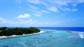 P02374 Aerial flying drone view of Maldives white sandy beach on sunny tropical paradise island with aqua blue sky sea Stock Images