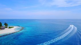 P01254 Aerial flying drone view of Maldives white sandy beach on sunny tropical paradise island with aqua blue sky sea. Aerial flying drone view of Maldives Stock Image