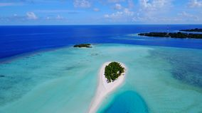 P00104 Aerial flying drone view of Maldives white sandy beach on sunny tropical paradise island with aqua blue sky sea water ocean Royalty Free Stock Photography