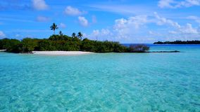 P00127 Aerial flying drone view of Maldives white sandy beach on sunny tropical paradise island with aqua blue sky sea water ocean Royalty Free Stock Image