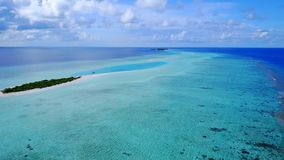 P00093 Aerial flying drone view of Maldives white sandy beach on sunny tropical paradise island with aqua blue sky sea water ocean Stock Photo