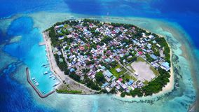 P00114 Aerial flying drone view of Rasdhoo in Maldives white sandy beach on sunny tropical paradise island with aqua blue sky sea Royalty Free Stock Photography