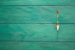 Pławik na drewnianej powierzchni Zdjęcie Royalty Free