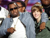 P Diddy and Justin Bieber perform stock photography