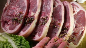 Leg of lamb steak sprinkled with pepper Stock Footage