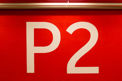 P2 huge sign painted on red wall Royalty Free Stock Image