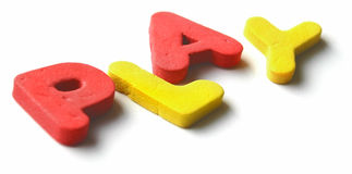 P.L.A.Y. at an angle. Foam toy-letters forming the word PLAY. P and Y are slightly out of the focus field. Sense of depth Stock Image