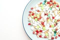 p?ldoras, drogas, farmacia, medicina o m?dico en la placa fotografía de archivo libre de regalías