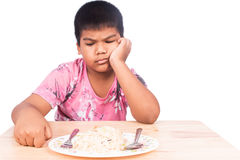 P little boy bored with food stock images