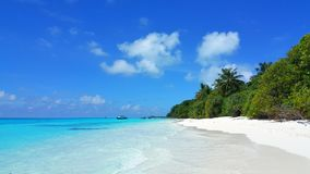 P00624 Maldives beautiful white sandy beach background with palm trees on sunny tropical paradise island with aqua blue sky sea wa. Maldives beautiful white Stock Photography