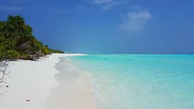 P00647 Maldives beautiful white sandy beach background with palm trees on sunny tropical paradise island with aqua blue. Maldives beautiful white sandy beach Stock Photo