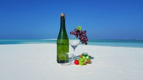 P01459 Maldives white sandy beach champagne bottle and glass on sunny tropical paradise island with aqua blue sky sea Royalty Free Stock Photos