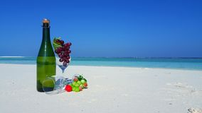P02875 Maldives white sandy beach champagne bottle and glasses on sunny tropical paradise island with aqua blue sky sea Royalty Free Stock Image
