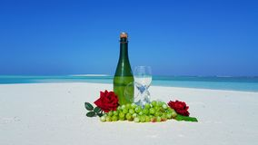 P02872 Maldives white sandy beach champagne bottle and glasses on sunny tropical paradise island with aqua blue sky sea Royalty Free Stock Photography