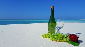 P02873 Maldives white sandy beach champagne bottle and glasses on sunny tropical paradise island with aqua blue sky sea Stock Photography